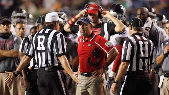 Florida Atlantic Owls coach Carl Pelini yells at the referees during the fourth quarter at Rice Stadium.