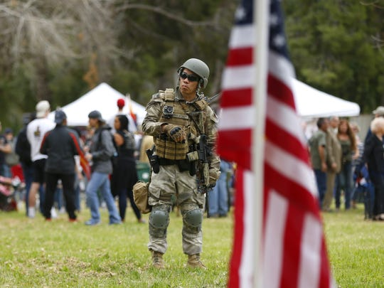 An armed citizen (didn't want his name disclosed) protects the park during a Trump Rally at Cactus Park in Phoenix on March 10, 2018.