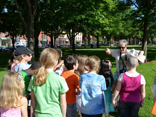 Historian Elise Guyette, director of Turning Points in American History, explains how people who broke the law where once held in stockades and hanged in City Hall Park when the county jailhouse was there. The students took a walking history tour through Burlington, Thursday.