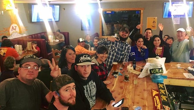 A larger group gathers to enjoy the 2016 Super Bowl at Anahiem Jack's.
