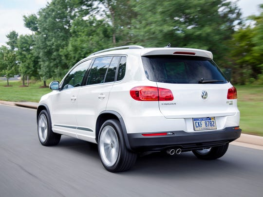 The 2014 Volkswagen Tiguan R-Line stands upright on 19-inch alloy wheels shod with low-profile all-season tires. Body-color side skirts with chrome trim, wheel arch extensions, unique rear spoiler and LED license plate illumination look serious.