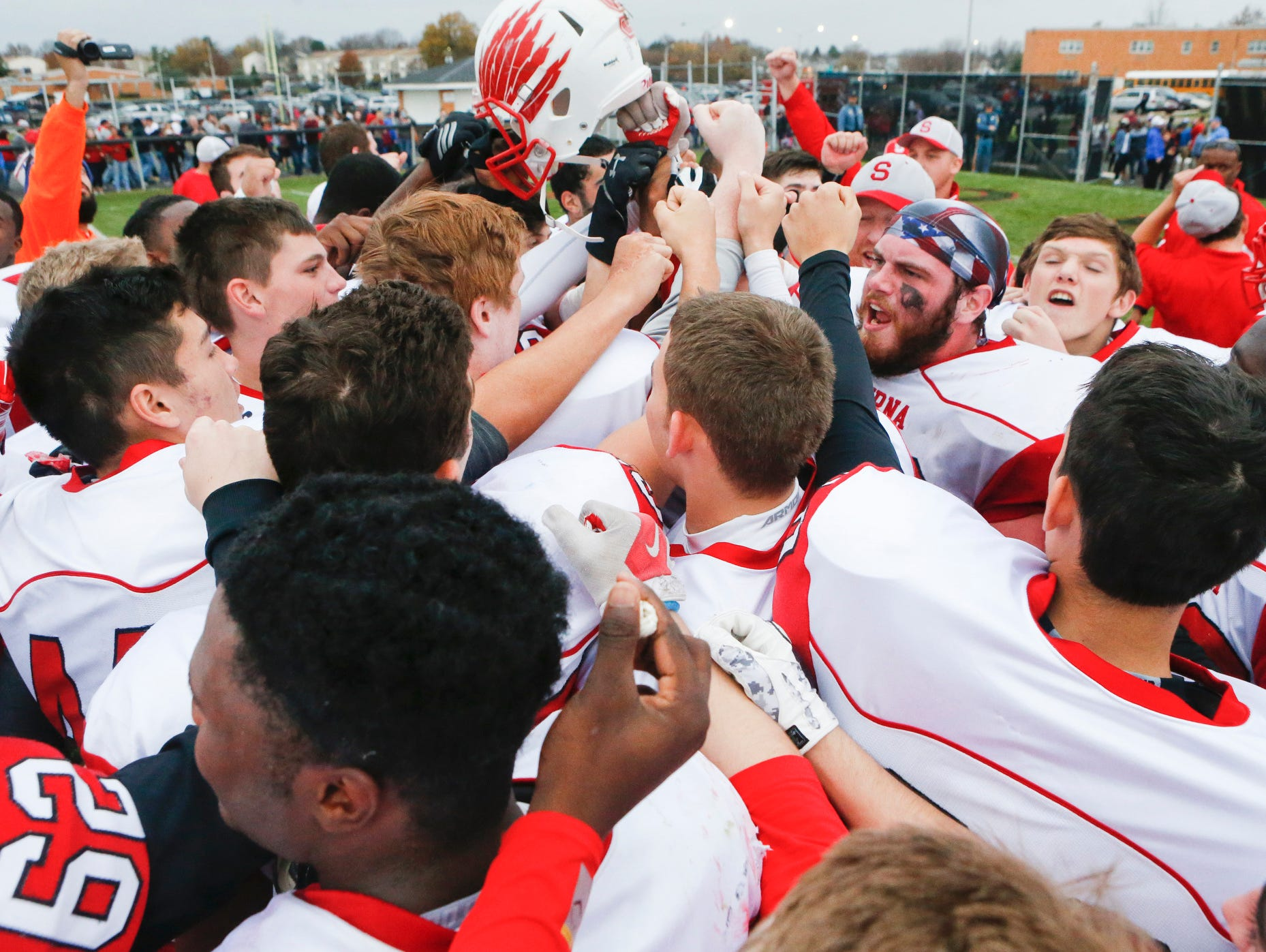 The Eagles celebrate as a team after beating William Penn 30-13 in a semifinal of the DIAA Division I state tournament at Bill Cole Stadium Saturday.