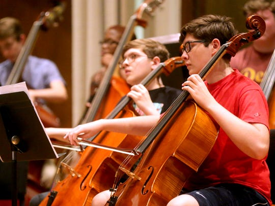Nathan Smith, 17, left and Eric Rice, 16 play cello
