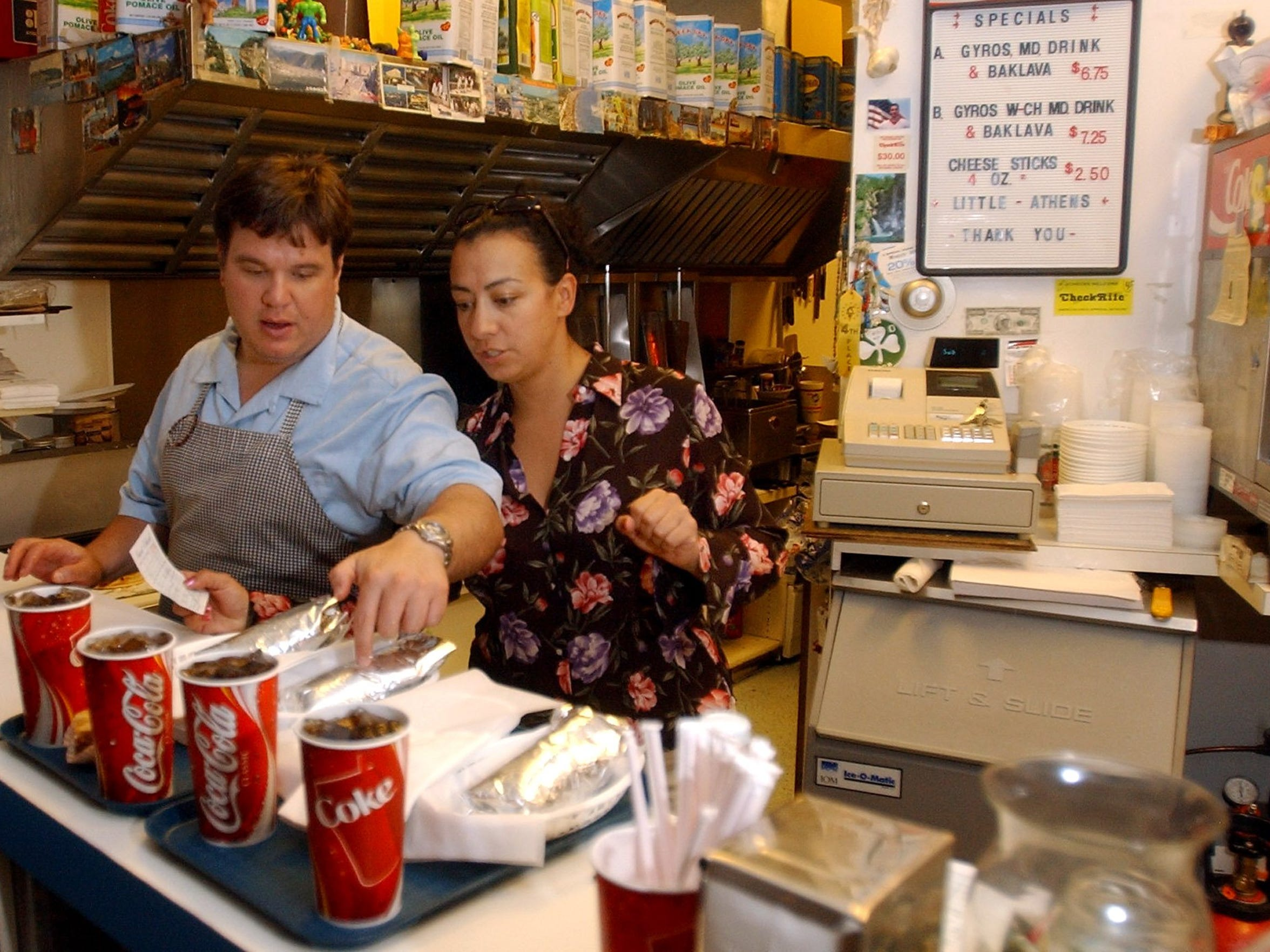 Nick and Linda Geranios put together orders at Little Athens in Holiday Mall on July 19, 2005. They and other family members operated the restaurant while their parents traveled to Greece.