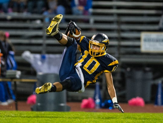 Elco's Nate Beamer falls to the ground after intercepting