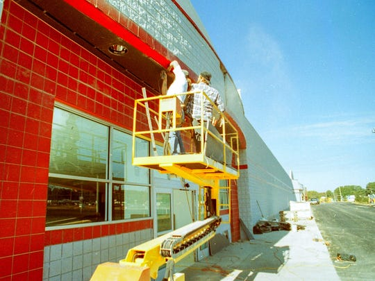 Construction workers painting the Big Kmart on Clemson Boulevard in Anderson on Oct. 25, 1995.