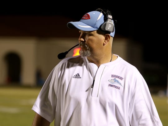 Hirschi head coach Danny Youngs walks along the sideline during the game against Decatur Friday, Oct. 20, 2017, in Decatur at Eagles Stadium.