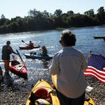 Kayaks, canoes and homemade watercraft take to the water as the Great Willamette River Raft Race shoves off from Riverview Park in Independence in 2014.