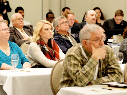 People listen to the LSUS debate team discuss physician assisted suicide Friday afternoon at the Shreveport Convention Center.