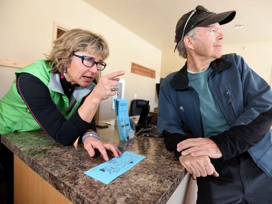 Cindy Dunbar, left, talks to Tim Tischler about snowshoe