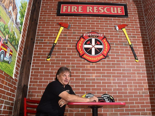Darin Fitzgerald talks on Wednesday about his new restaurant, Firehouse Subs, in the San Juan Plaza in Farmington.