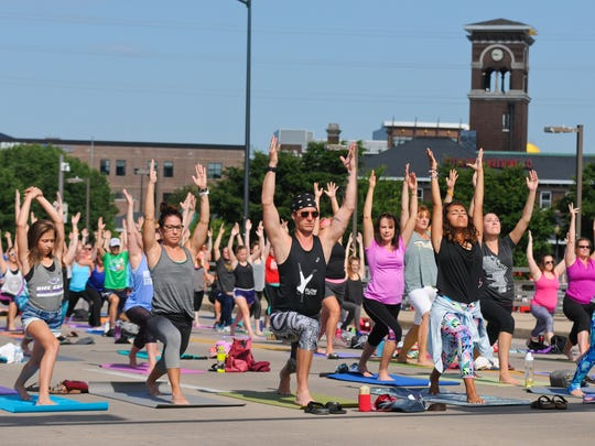 A Yoga class was held on Main Street's Ray Nitschke