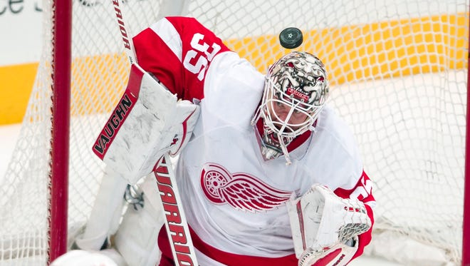 Red Wings goalie Jimmy Howard (35) stops a shot by the Stars during the first period at American Airlines Center Monday.