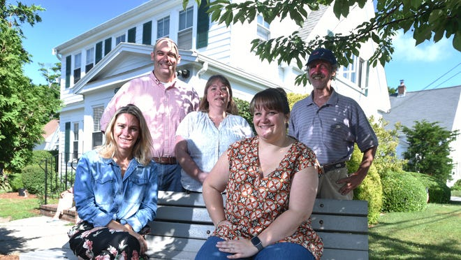 The staff at Champ Homes in Hyannis is rebounding after 15 residents of the organization's School Street home were infected with COVID-19 this spring. Seated from left are Jennifer Pare and Suzanne Tabot. Standing from left are Adam Burnett, Nichole Graff and Paul Costa.