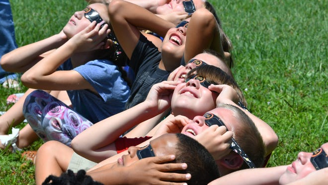 At Ocean Breeze Elementary School in Indian Harbour Beach,first through sixth grades went outside to view the solar eclipse with the correct glasses. Pre-k and kindergarten viewed the event on televisions in the classroom.