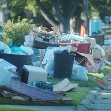 Garbage piles, like these on Kenmore north of Catalpa in Berkley, are starting to smell and attract rodents and flies.