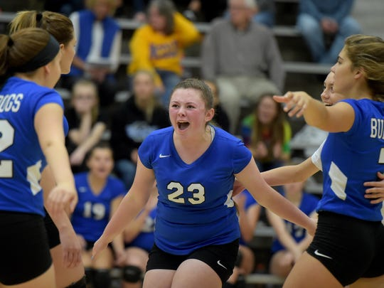 Centerville volleyball players celebrate Saturday,