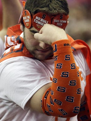 A Syracuse fan celebrates during a 2016 football game at the Carrier Dome. Syracuse University is moving to mobile ticketing beginning this fall, if games are played.