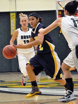 Ariel Granillo, an ICAN alum, dribbles through the defense as a member of the South Dakota School of Mines & Technology basketball team.
