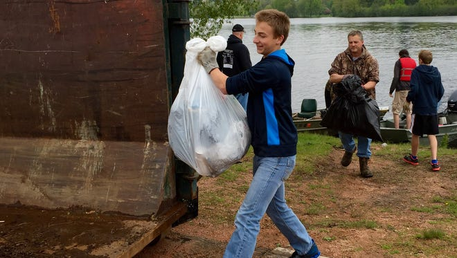 Roughly 350 people turned out to different areas of Wisconsin River Friday to participate in the 16th annual Wisconsin River Cleanup.