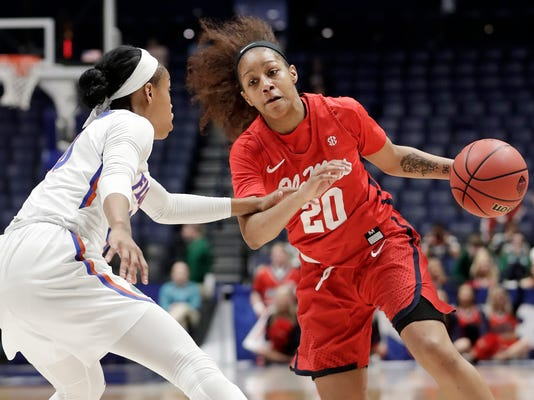 Mississippi guard Madinah Muhammad (20) drives against Florida guard Delicia Washington, left, in the first half of an NCAA college basketball game at the women's Southeastern Conference tournament Wednesday, Feb. 28, 2018, in Nashville, Tenn. (AP Photo/Mark Humphrey)