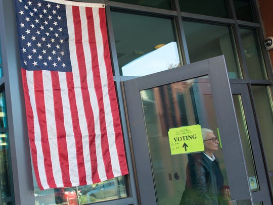 A voter exits Tenakill Middle School in Closter after