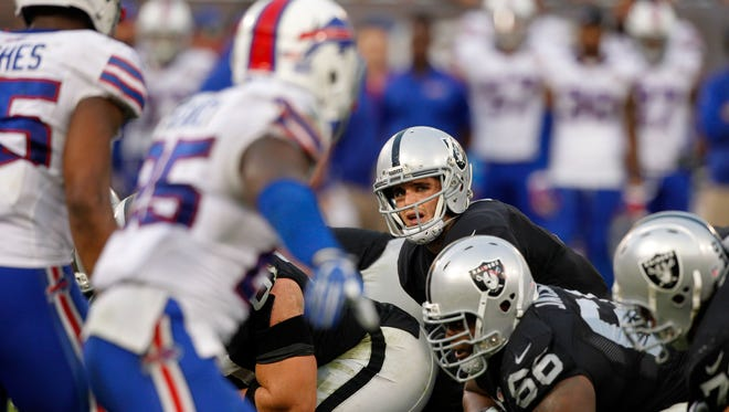 Raiders quarterback Derek Carr prepares to take a snap against the Buffalo Bills during the 2014 season.