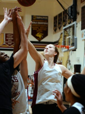 Oaks Christian's Sydney Boyer practices with her teammates on Thursday. Boyer is averaging 16 points a game for the Lions, who are tied for the Marmonte League lead.