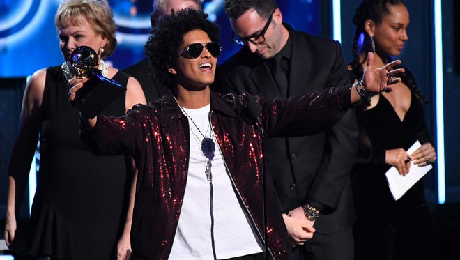Bruno Mars accepts Record Of The Year for 24K Magic during the 60th Annual Grammy Awards at Madison Square Garden.