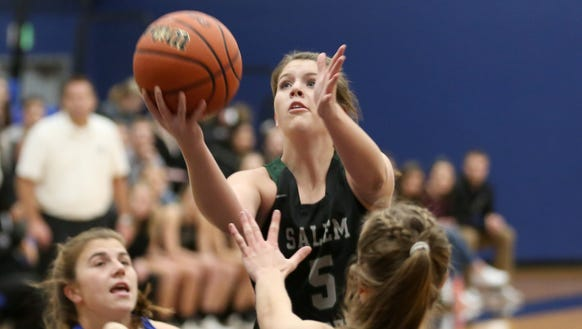 Salem Academy's Aimee Smith (5) goes for the basket