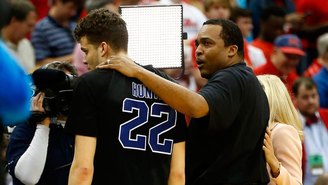 Head coach Ron Hunter of the Georgia State Panthers puts his arm around son and player R.J. Hunter #22 after the Panthers 57-56 win against the Baylor Bears during the second round of the 2015 NCAA Men's Basketball Tournament at Jacksonville Veterans Memorial Arena on March 19, 2015 in Jacksonville, Florida.