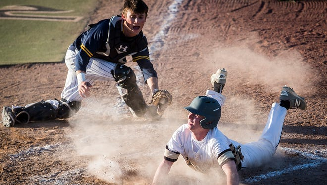 Daleville's Max Stecher slides home against Delta during their game at Yorktown High School Tuesday, May 8, 2018.