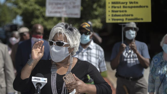 Pastor Angela Harden speaks to reporters as Green Meadows residents protest the building of a proposed drug treatment center in their neighborhood Monday morning August 17, 2020 in Augusta, Ga.