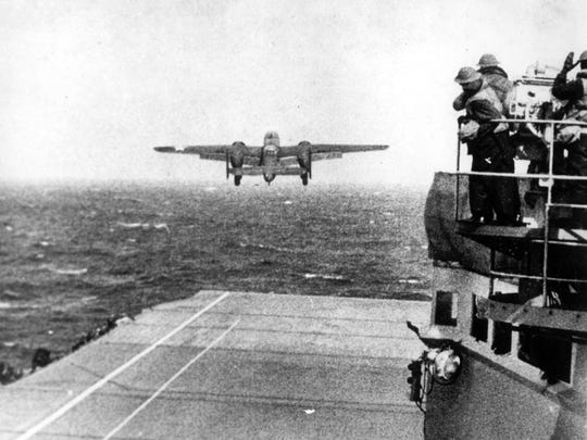 In this April 18, 1942, file photo, one of Lt. Col. Jimmy Doolittle's B-25 bombers takes off from the flight deck of the USS Hornet for the initial air raid on Tokyo. Coming just four months after the Imperial Japanese Navy savaged the U.S. Pacific Fleet at Pearl Harbor, the Doolittle raid on Japan's home did little damage, but lifted the spirits of Americans and electrified a world at war.