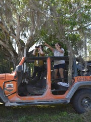 Collier Citizen reporter Ashley Collins, left, and Marisol Morales with Orange Jeep Tours watch birds fly over natural preserve near Ave Maria on March 28, 2017.