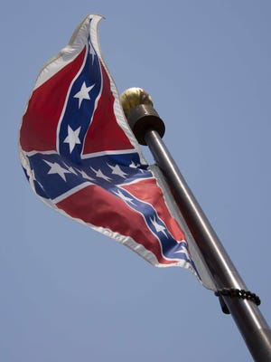 The Confederate Flag flies on the South Carolina State House grounds in Columbia, South Carolina, June 24, 2015. A symbol of valor and honor for some, but of support for slavery and racial hatred for others, the Confederate flag South Carolina's governor now wants stowed has had a thorny history for a century and a half. AFP PHOTO/JIM WATSONJIM WATSON/AFP/Getty Images