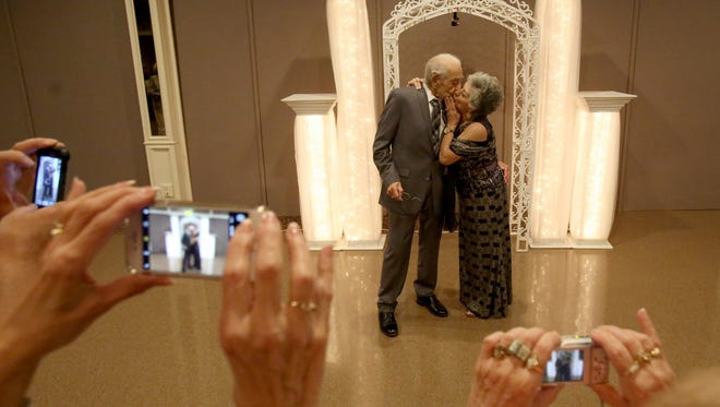 After 70 years of marriage Tony George, 93 and Sophia George, 88 share a kiss with each other during their 70th wedding anniversary party on April 23, 2017.