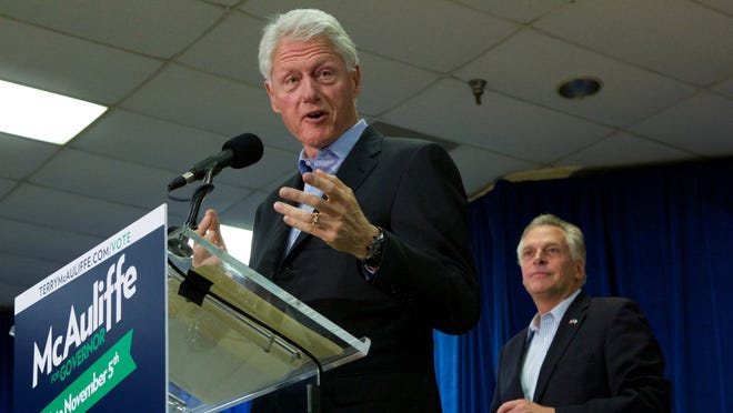 """Former President Bill Clinton campaigns for Democratic gubernatorial candidate for Virginia, Terry McAuliffe, right, at a """"Putting Jobs First"""" event in Dale City, Va., on Sunday."""