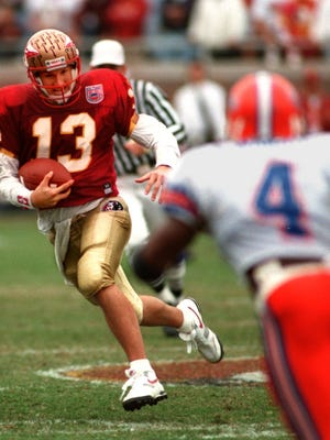 Florida State quarterback Danny Kanell breaks off for a run against Florida on Nov. 26, 1994. The Seminoles rallied from a 31-3 deficit to finish the game tied at 31.