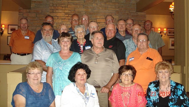 The 21 classmates who attended the Auburndale High School class of 1960 reunion included: (at front) Lucille (Schill) Oertel, from left, Gail (Robinson) Lasecke, Donna (Bulgrin) Altmann and Betty Lou (Kolbeck) Kaiser; (second row) Bev (Altmann) Weidman, Duke Weidman and Wayne Mueller; (third row) Evan Butterbrodt, Marilyn (Marti) Pederson, Len Strigel and Ron Stoflet; (fourth row) Joyce (Jadack) Durrant, Marvin Konopa and Doug Wolcott; (at back) Carl Mielke, Ron Collins, John Bauer, Roy Newby, Bob Brandl, Dick Witt and Emil Oertel.