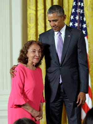 Miriam Colon is pictured next to President Obama in 2015 before receiving the National Medal of Art award for her work as an actress and theater founder.