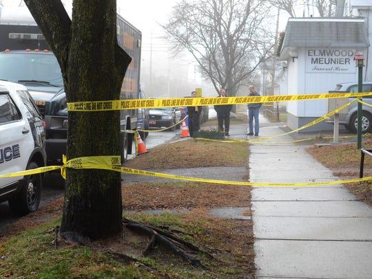 Investigators continue to work at 101 Elmwood Avenue