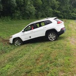 """A Jeep Cherokee winds up in a ditch after hackers working with """"Wired"""" magazine successfully take control of the vehicle by hacking in through its connected-car infotainment system."""
