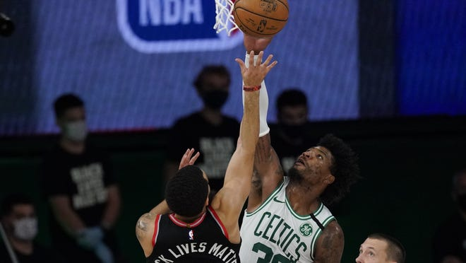 Celtics guard Marcus Smart (middle) blocks a shot by Raptors guard Fred VanVleet (left) during the second half of Game 4 of the Eastern Conference semifinals. Smart will most likely be the primary defender on Heat forward Jimmy Butler as the Celtics will have to keep up their defensive intensity in order to slow down the Miami offense.