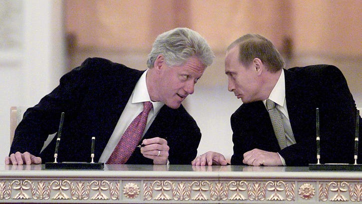 President Bill Clinton, left, and Russian President Vladimir Putin spoke after signing a memorandum of agreement to establish a joint center for the exchange of data from early warning systems and notifications of missile launches at in Moscow, Russia on June 4, 2000.