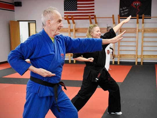 Black belt Ray Dinius works with instructor Denise