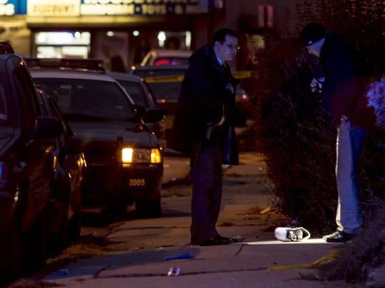 Wilmington police officers investigate a shooting scene in the 2300 block of Lamotte St. in the city on Dec. 21.