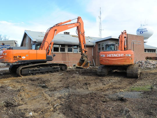 Crews demolish the Rehoboth Beach City Hall on Feb. 1. Officials have put measures in place to stem runoff from the site.