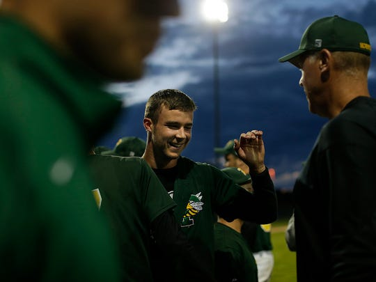 Green Bay Preble pitcher Caleb Schoenholz is congratulated by his coaches after throwing a no-hitter against Green Bay West/East during a WIAA Division 1 sectional finals in June at Bay Port High School in Suamico.