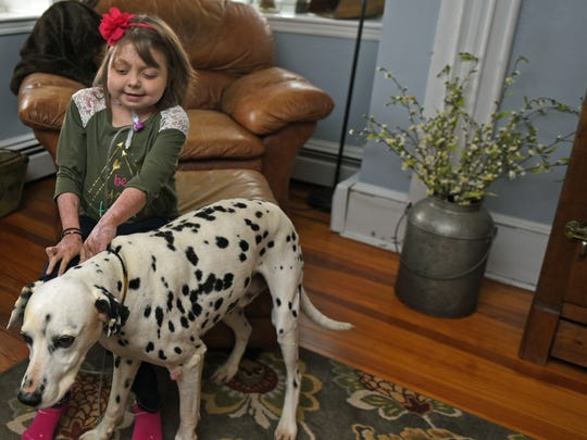 Reese Burdette, of Mercersburg, who was injured in a house fire on Memorial Day in 2014, plays with her dog at her parent's home on Friday, April 7, 2017. The 10-year-old is now in need of a new kidney.